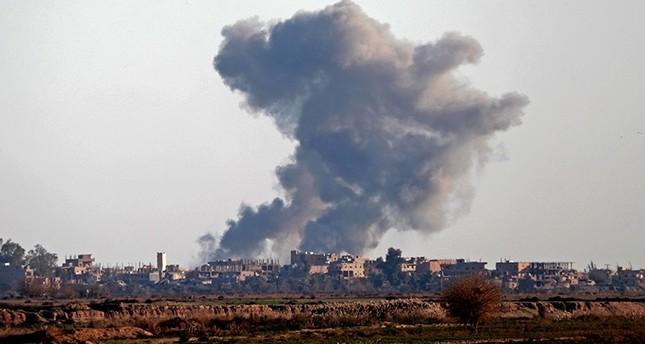 Smoke billows after bombings in the Deir el-Zour province, near Hajin, eastern Syria, on Dec. 15, 2018. AFP Photo