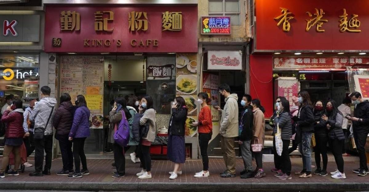 People queue up to buy face masks at a cosmetics shop in Hong Kong, Thursday, Jan. 30, 2020. (AP Photo)