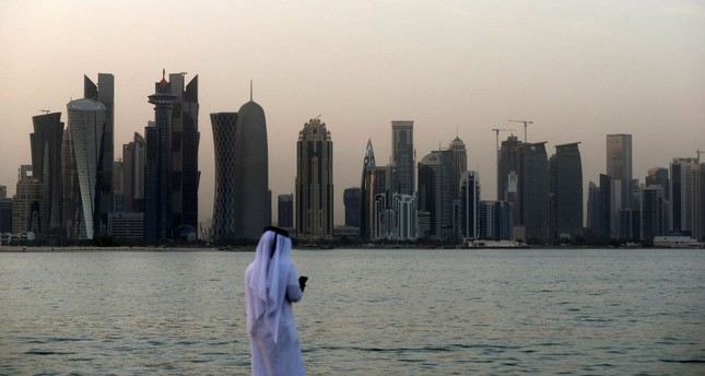 A man looks at his phone in the Qatari capital Doha, July 2.