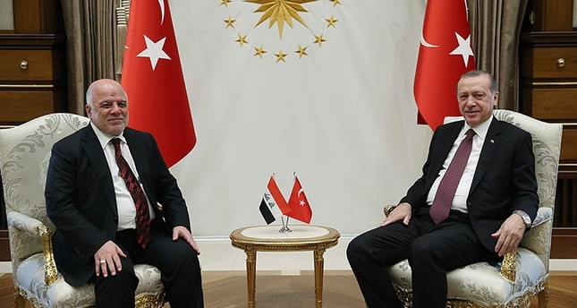 President Recep Tayyip Erdoğan (R) and Iraqi Prime Minister Haider al- Abadi pose for a photo before a meeting at presidential palace, Ankara, Turkey, Oct. 25, 2017. (PresIdential Press Service)