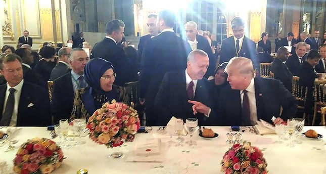 President Recep Tayyip Erdoğan (C), first lady Emine Erdoğan (L) and U.S. President Donald Trump (R) talk during dinner hosted by French President Emmanuel Macron in Paris. (AA Photo)