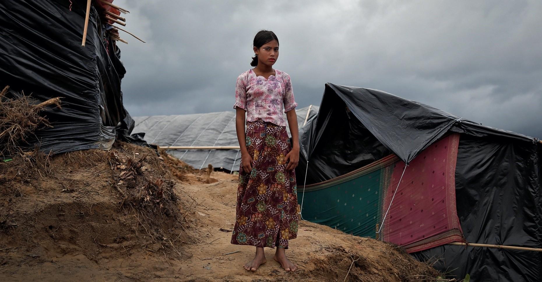 A Rohingya refugee girl poses in Coxu2019s Bazar, Sept. 28, 2017.