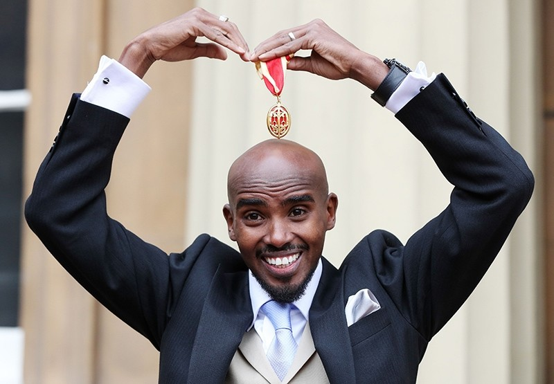 Britain's Mo Farah does his trademark Mobot as he poses with his medal after being knighted as a Knights Bachelor (Knighthood) during an investiture ceremony at Buckingham Palace,London, U.K., Nov. 14, 2017. (AFP Photo)
