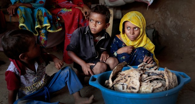 In this Oct. 1, 2018 file photo, children sit in front of moldy bread in their shelter, in Aslam, Hajjah, Yemen. (AP Photo)