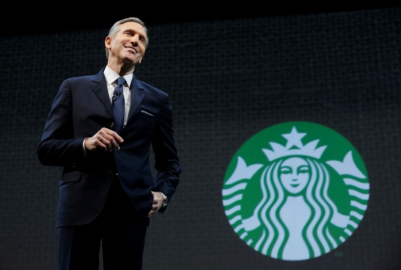In this March 18, 2015, file photo, Starbucks CEO Howard Schultz speaks at the coffee company's annual shareholders meeting in Seattle. Starbucks Corp. says Schultz is stepping down as executive chairman later this month. (AP Photo)