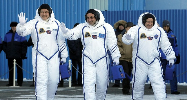 Members of the International Space Station expedition 54/55, Roscosmos cosmonaut Anton Shkaplerov (C), NASA astronaut Scott Tingle (R) and Norishige Kanai (L) of the Japan Aerospace Exploration Agency (JAXA) during the send-off ceremony. (EPA Photo)