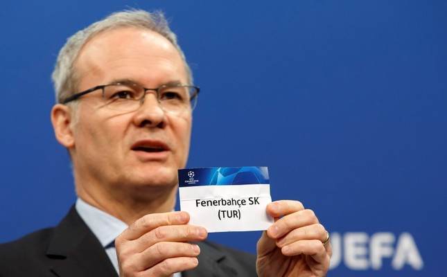 UEFA Deputy Secretary-General Giorgio Marchetti shows a ticket of Fenerbahçe during the drawing of the fixtures for the Champions League 2018/19 third qualifying round at the UEFA headquarters in Nyon, Switzerland, July 23, 2018. (AFP Photo)