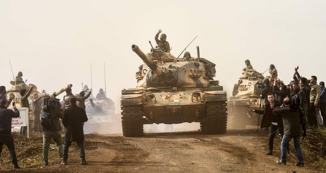 Turkish troops drive into Syria near Hassa on the Turkish-Syria border, Hatay, Jan. 22. (AFP Photo)