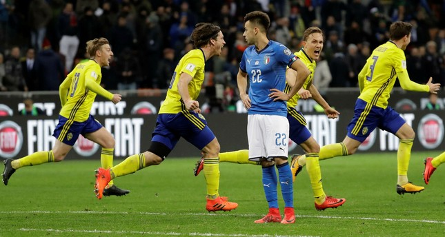 Swedish players run past Italy's Stephan El Shaarawy as they celebrate qualifying at the end of the World Cup qualifying play-off second leg soccer match between Italy and Sweden, at the Milan San Siro stadium, Italy, Monday, Nov.13, 2017. (AP Photo)