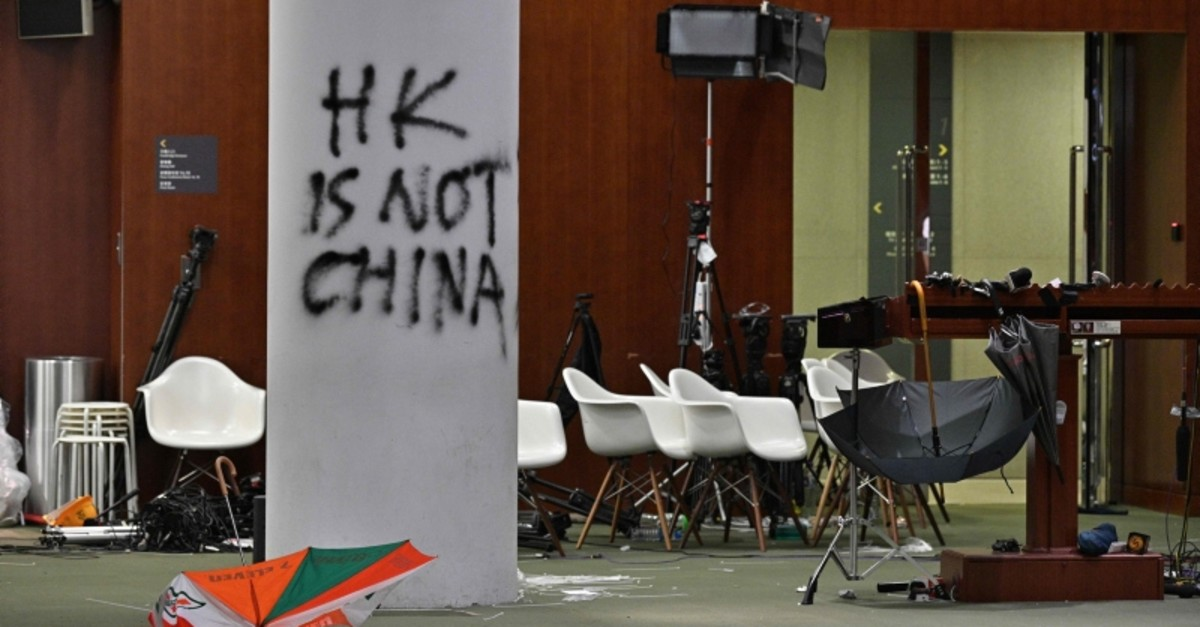Graffiti and umbrellas are seen outside the main chamber of the Legislative Council during a media tour in Hong Kong on July 3, 2019, two days after protesters broke into the complex. (AFP Photo)