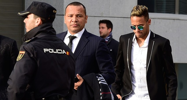This file photo taken on February 02, 2016 shows Barcelona's Brazilian forward Neymar (R) and his father Neymar Santos arriving at Spain's national court in Madrid. (AFP Photo)
