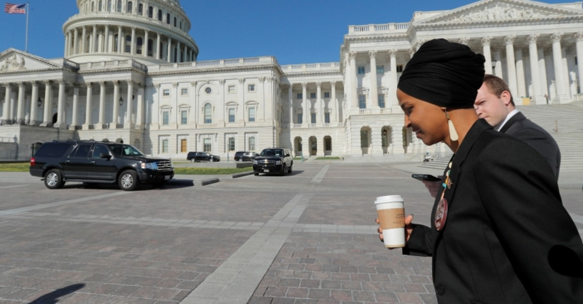 Rep. Ilhan Omar (D-MN) talks to reporters as she heads back into the U.S. Capitol after a news conference by members of the U.S. Congress (Reuters Photo)