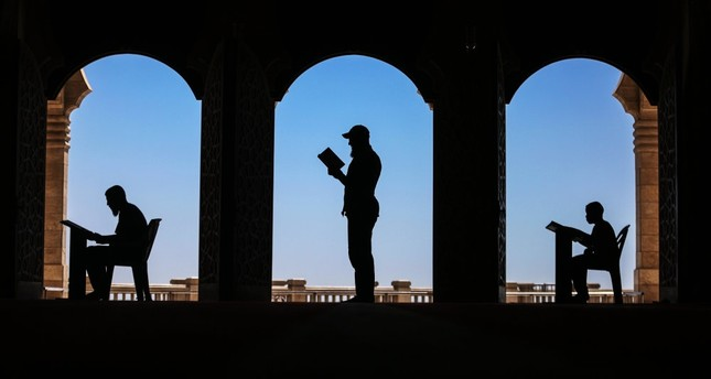 Palestinian Muslims reading the Quran in the Great Omari Mosque in Gaza during the holy month of Ramadan, June 3.