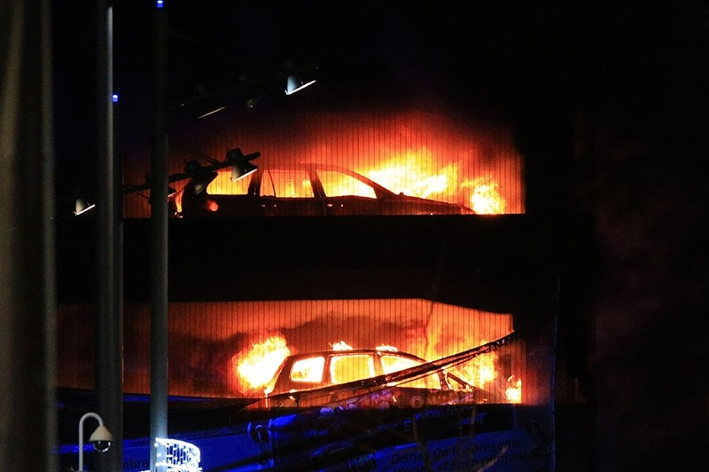 Vehicles burn during a blaze at a multi-storey car park at the Echo Arena on the waterfront in Liverpool, England, Dec. 31, 2017. (Peter Byrne/PA via AP)