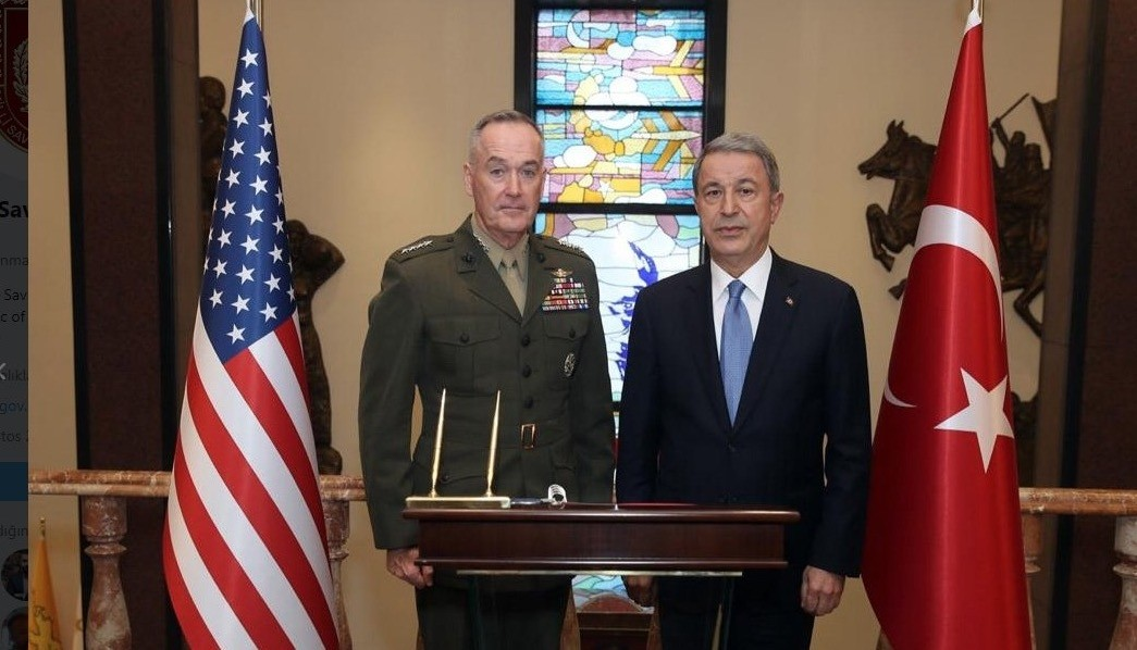 Turkish National Defense Minister Hulusi Akar (R) and U.S. Joint Chiefs Chairman Gen. Joseph Dunford