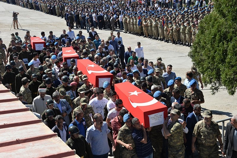 Coffins of soldiers who died in the helicopter crash are being carried on shoulders to placed in military aircraft to be send to their hometowns, in Turkey's eastern province of u015eu0131rnak, June 1, 2017. (DHA Photo)