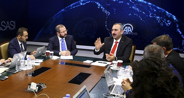 Justice Minister Abdulhamit Gül (center) speaking on Anadolu Agency's Editor's Desk on Oct. 19, 2017 (AA Photo)