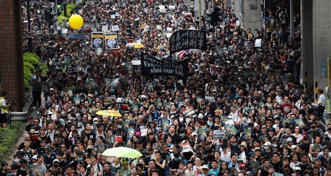 Protesters march through the Sha Tin District in Hong Kong, Sunday, July 14, 2019. (AP Photo)