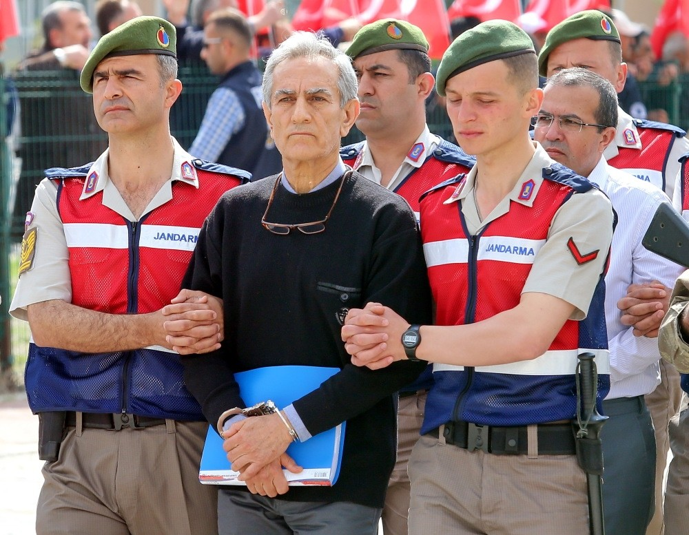 Aku0131n u00d6ztu00fcrk, former Air Forces commander accused of commanding the putschists, was escorted to the courtroom by gendarmerie troops.