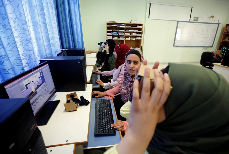 Palestinian students, who will compete in the International Technovation entrepreneurship program, work on computers at An-Najah National University in Nablus in the occupied West Bank. (Reuters Photo)