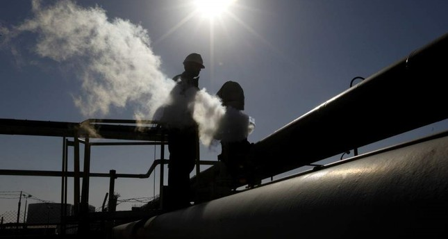 In this Feb. 26, 2011 file photo, a Libyan oil worker, works at a refinery inside the Brega oil complex, in Brega, eastern Libya. AP Photo