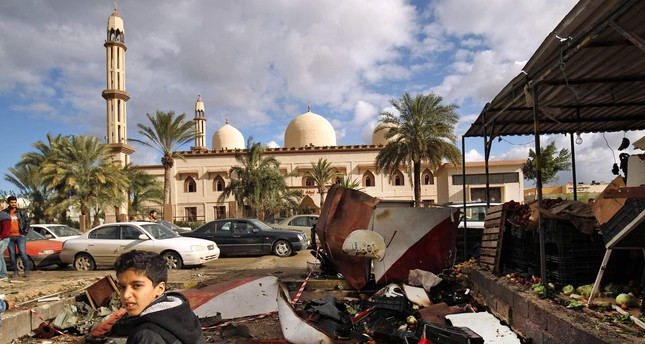 Twin car bombs rock Benghazi, Libya, dozens dead