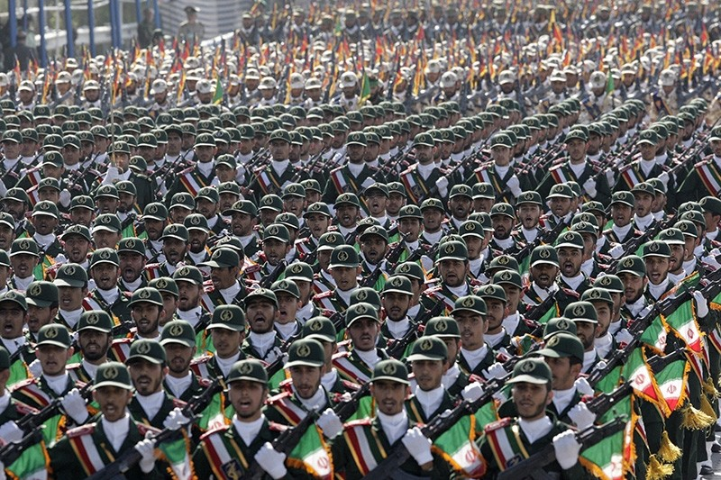 In this Sept. 22, 2011 file photo, Iran's Revolutionary Guard members march during armed forces parade marking the anniversary of the start of the 1980-88 Iraq-Iran war, just outside Tehran, Iran. (AP Photo)