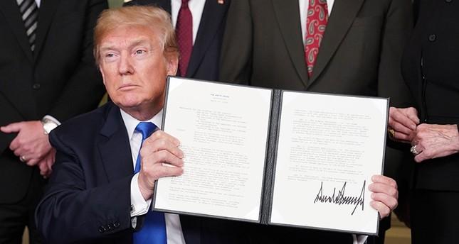 واشنطن تعلن تعليق الرسوم الجمركية على الصين