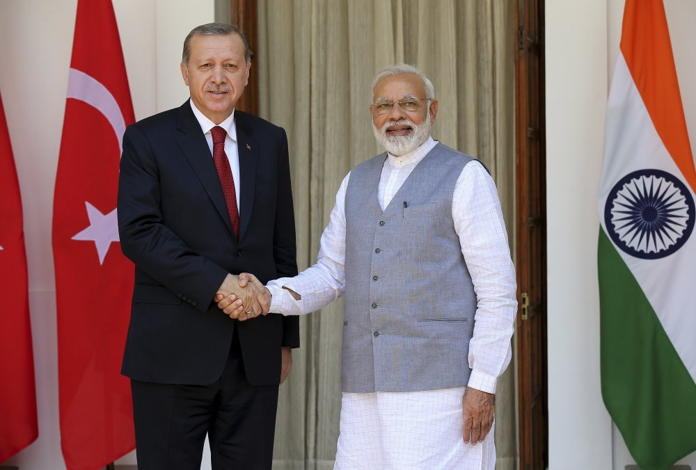Turkish President Recep Tayyip Erdou011fan (L) and Indian Prime Minister Narendra Modi (R) shake hands upon their arrival at Hyderabad House prior to their meeting in New Delhi, India, May 1 2017.