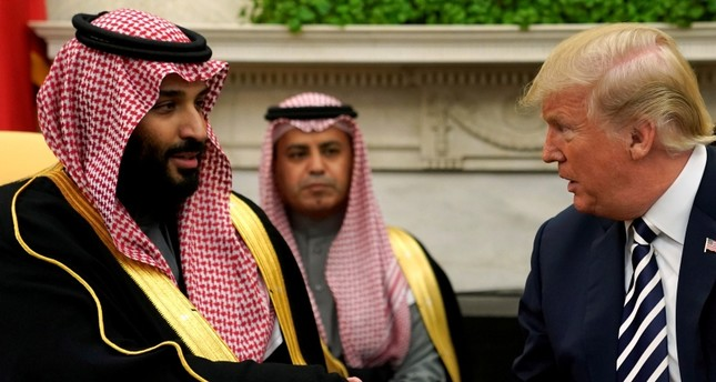 U.S. President Donald Trump shakes hands with Saudi Arabia's Crown Prince Mohammed bin Salman in the Oval Office at the White House in Washington (Reuters File Photo)