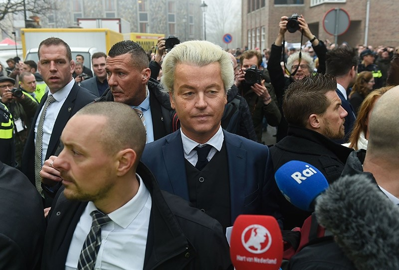 Dutch far-right politician and leader of the Freedom Party Geert Wilders (C) looks towards journalists as he officially launches his parliamentary election campaign in Spijkenisse on February 18, 2017. (AFP Photo)