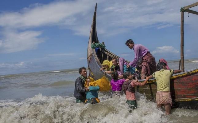 In this Sept. 14, 2017 photo, Rohingya Muslim arrive on a boat from Myanmar to Bangladesh in Shah Porir Dwip, Bangladesh. AP Photo