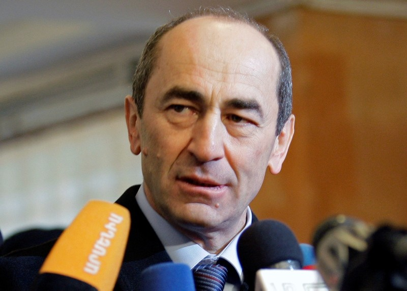 In this file photo dated Tuesday, Feb. 19, 2008, Armenian President Robert Kocharian talks to the media at a polling station in Yerevan, Armenia. (AP Photo)
