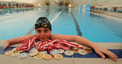 pBerkin Kutlu, an 11-year old boy with physical disabilities, overcame his fear of water and became Turkey's swimming champion, passing the threshold of qualifications set by the International...