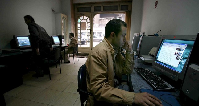 A man looking at a computer screen at an internet cafe in Cairo, Egypt. (EPA Photo)