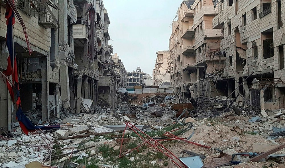 Damaged buildings due to fighting and Assad airstrikes in the town of Harasta, in eastern Ghouta region east of Damascus, Syria. (Danny Makki via AP)