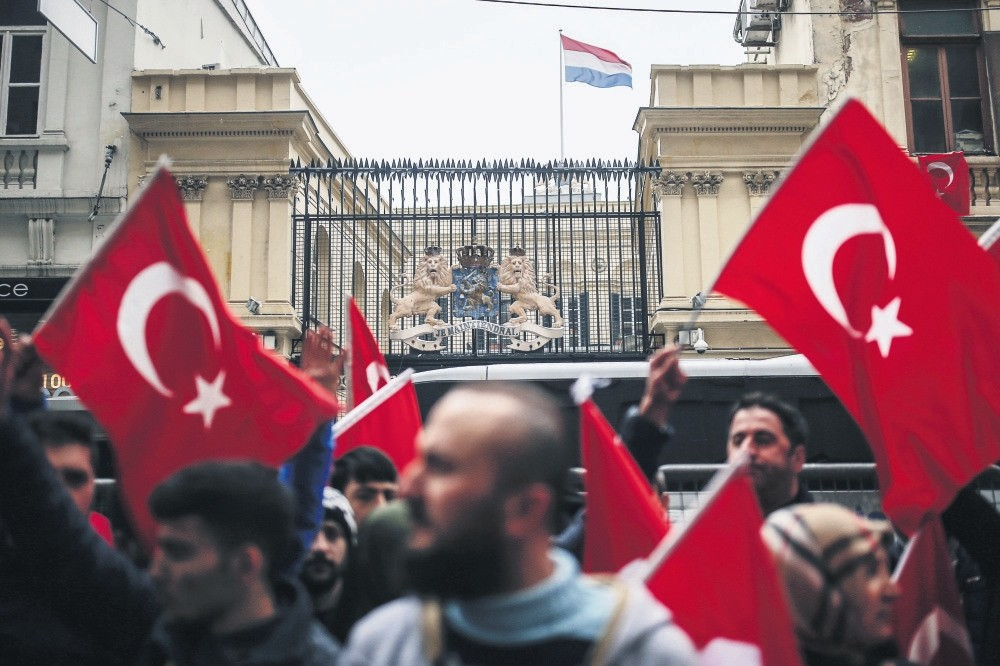 A group of Turkish people protesting the Dutch police's treatment of a Turkish minister in Rotterdam, outside the Dutch Consulate in Istanbul, March 12.