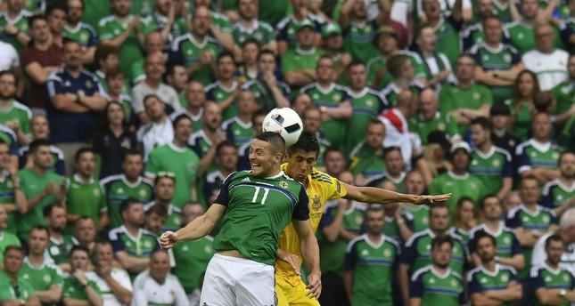 Northern Ireland's forward Conor Washington (L) and Ukraine's defender Yevhen Khacheridi during the Euro 2016 group C football match. (AFP PHOTO)