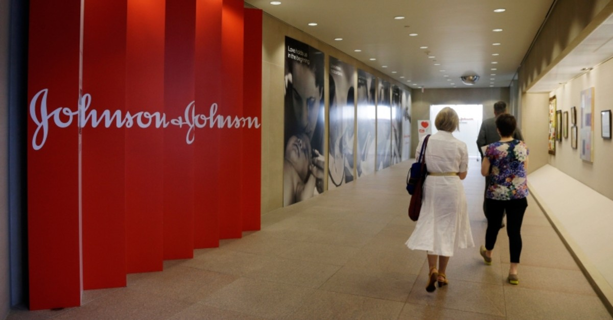 In this July 30, 2013, file photo, people walk along a corridor at the headquarters of Johnson & Johnson in New Brunswick, N.J. (AP Photo)