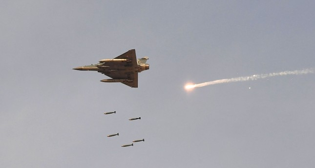 In this photo taken on February 16, 2019, an Indian Air Force IAF Mirage-2000 fighter aircraft drops bombs during the 'Vayu Shakti 2019' fire power demonstration AFP Photo