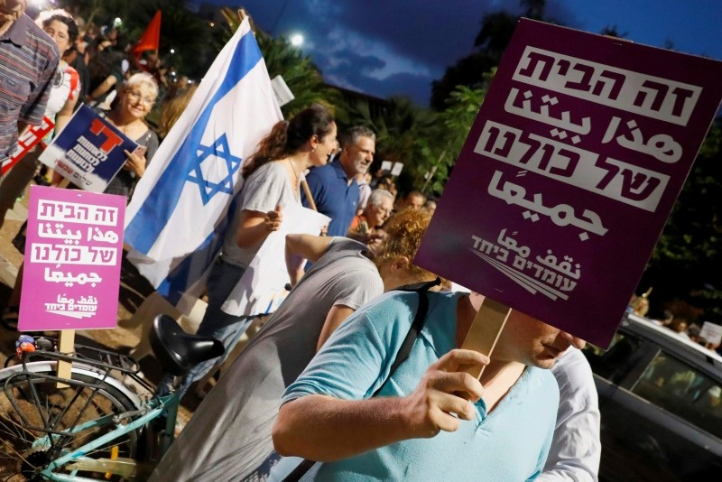 Demonstrators attend a rally to protest against the 'Jewish Nation-State Bill' in the Israeli coastal city of Tel Aviv on July 14, 2018. (AFP Photo)