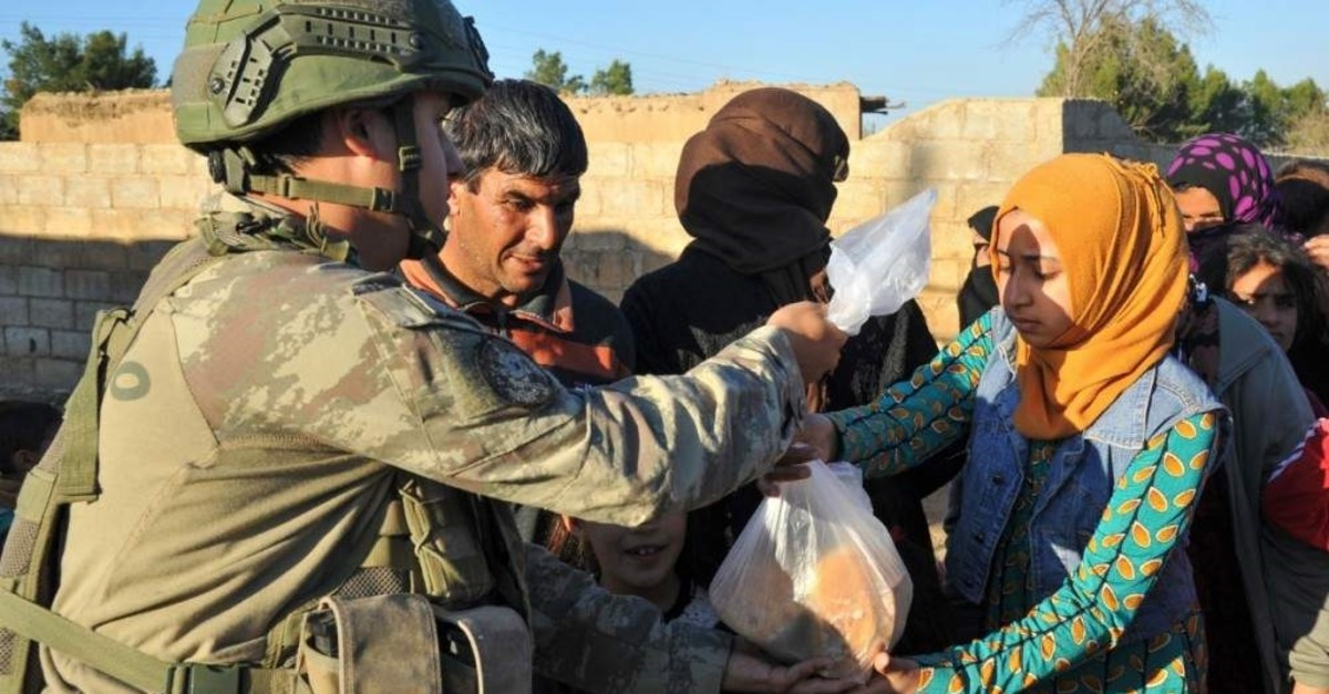 Turkish Armed Forces provide aid to locals in liberated areas of northern Syria after Operation Peace Spring. (National Defense Ministry - Anadolu Agency)