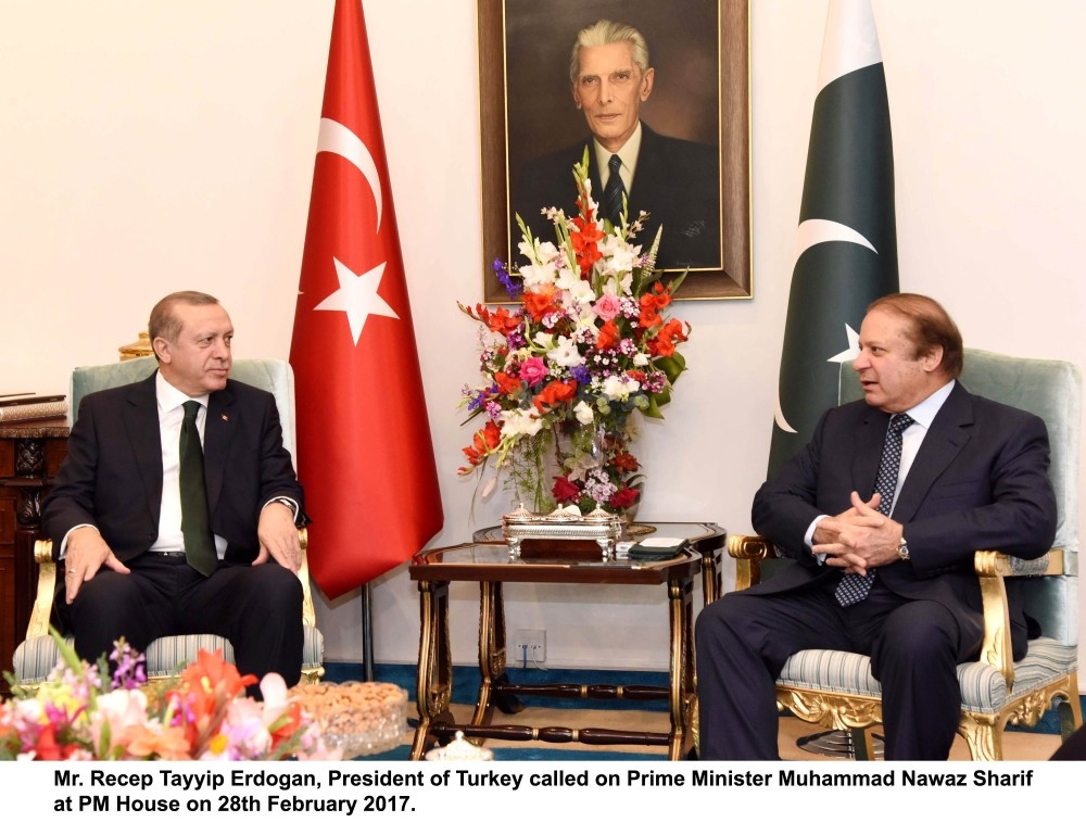 President Erdou011fan talking with Pakistani Prime Minister Muhammad Nawaz Sharif during their meeting at Pakistani Prime Minister House on Feb 28.