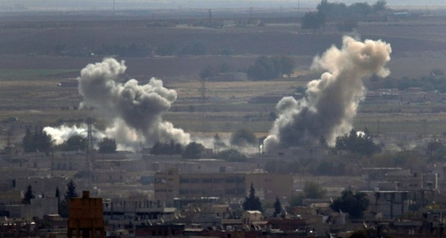 Smoke and dust billows from targets in Ras al-Ayn, Syria, caused by bombardment by Turkish forces, Tuesday, Oct. 15, 2019 (AP Photo)