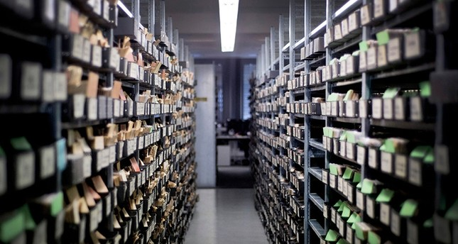 A picture taken on January 24, 2013 shows shelves with boxes of index cards keeping a record of German soldiers who died or went missing in war, in an archive room at the German Red Cross Tracing Service offices in Munich. (AFP Photo)