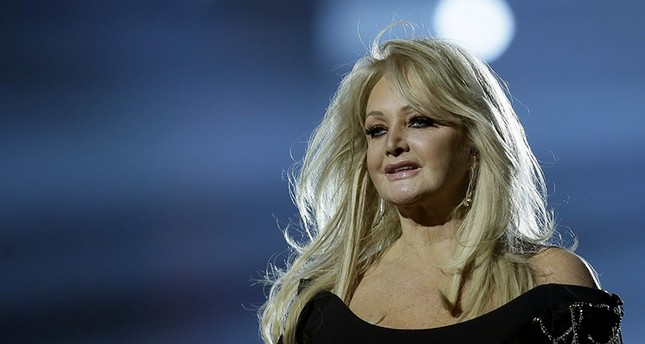 In this May 17, 2013, file photo, Bonnie Tyler performs her song Believe in Me during a rehearsal for the final of the Eurovision Song Contest at the Malmo Arena in Malmo, Sweden. (AP Photo)