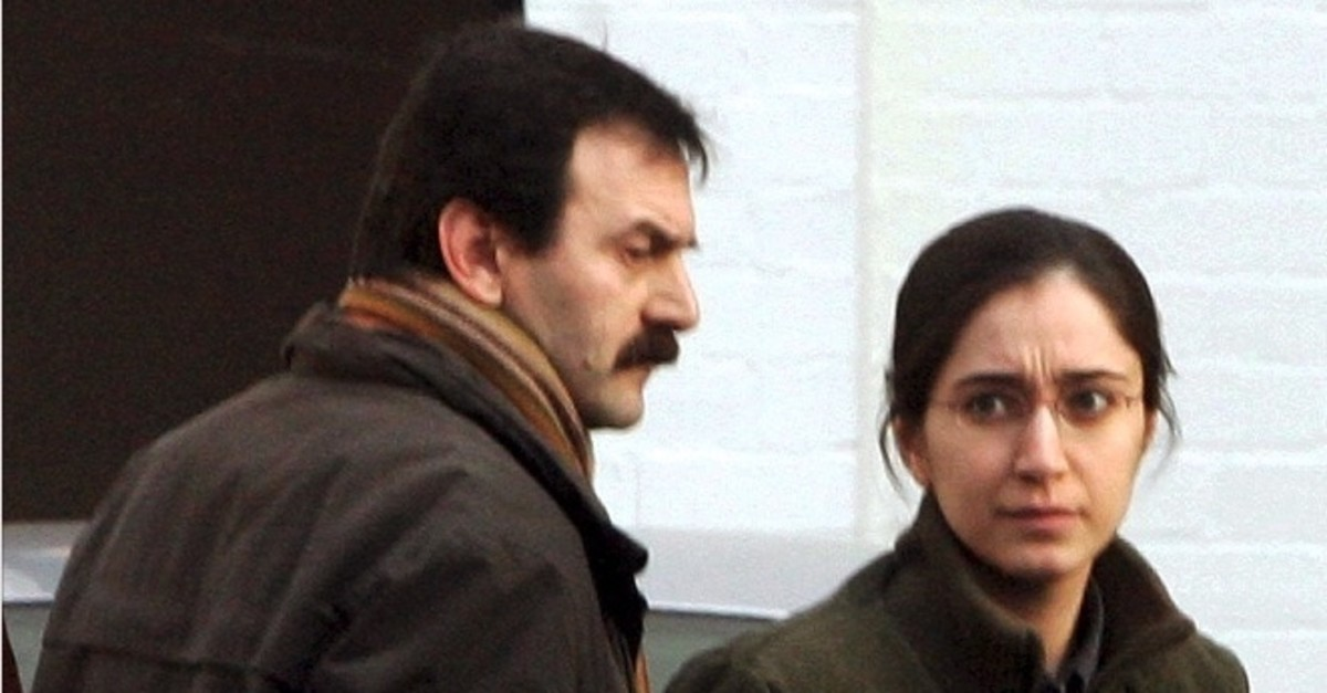 Fehriye Erdal (R) arrives at a courthouse with an unidentified man for her trial in Bruges, Jan. 25, 2006.
