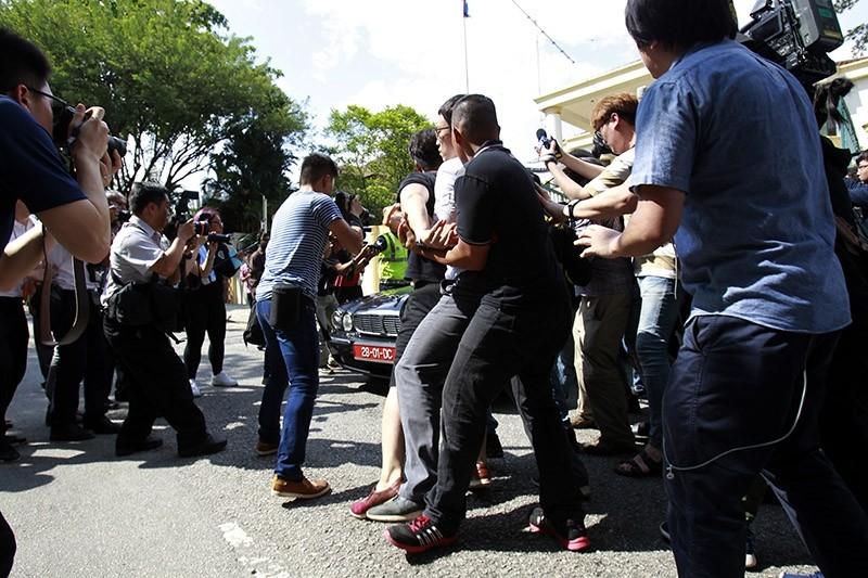 Journalists surround a car of North Korean Ambassador to Malaysia Kang Chol leaving North Korean Embassy in Kuala Lumpur, Malaysia, Monday, March 6, 2017. (AP Photo)