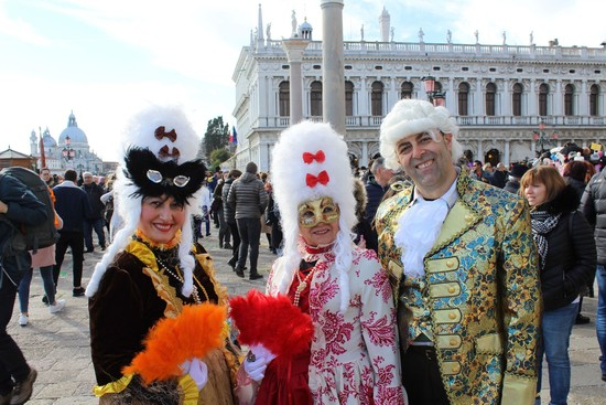 Dozens of people wearing costumes and masks fill the streets of Venice for the whole month of February. (Photo by Asene Asanova)