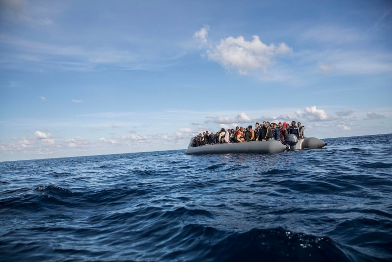 In this Friday, Dec. 21, 2018, photo, migrants sit in a rubber dinghy after Proactiva Open Arms, a Spanish NGO, spotted and rescued them in the Central Mediterranean Sea at 45 miles (72 kilometers) from Al Khums, Lybia. (AP Photo)